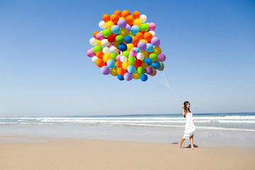 Beauty walking with ballons