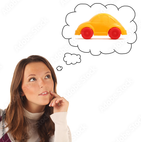 Girl dreaming about car (isolated)