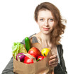 Smiling young woman with vegetables and fruits in shopping bag