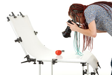 photographer girl in african braids with non reflective table