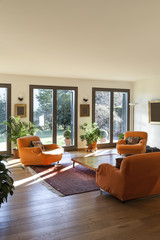 living room with orange armchairs