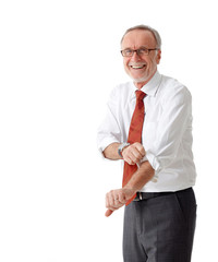 Isolated mature business man roll up his sleeves