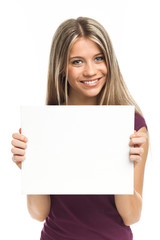 Young blond woman showing blank signboard