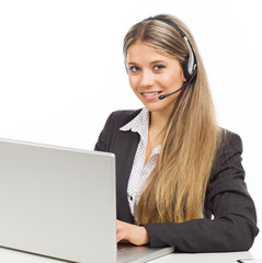 Smiling phone operator with laptop