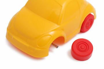 Toy car with broken wheel