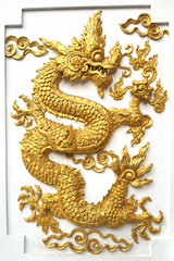 Gold dragon statue on the wall.