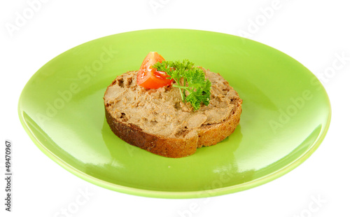 Toasted bread with pate on color plate, isolated on white