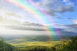 canvas print picture - summer landscape with rainbow green hills and clear blue sky