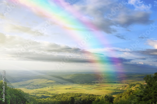 summer landscape with rainbow green hills and clear blue sky