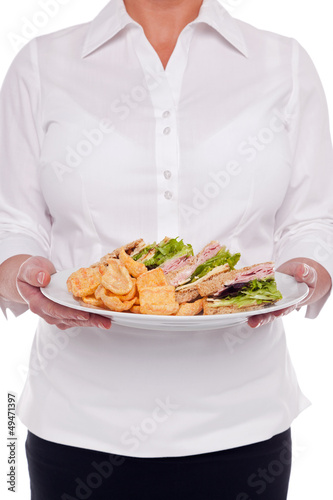 Waitress serving a sandwich