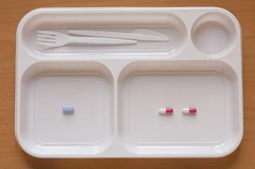 Close-up view of Pills in a food tray