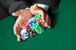 "Gambler stakes ""all in"" pushing his poker chips forward"