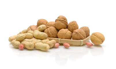walnuts and peanuts on a white background