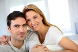 Portrait of in love couple sitting in sofa