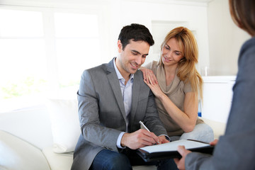 Couple signing terms of real-estate contract