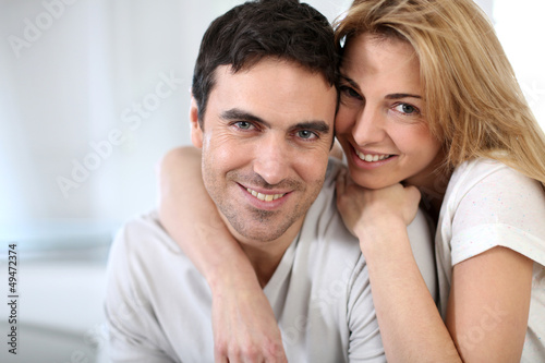 Cheerful couple embracing each other