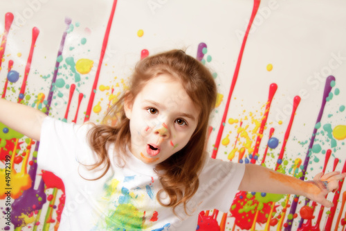 Child covered in paint