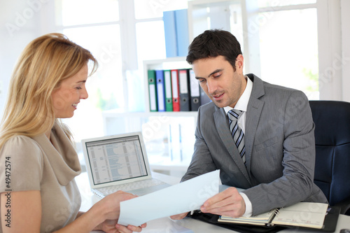 Woman meeting banker to set up her own business - 49472574