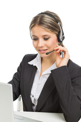 Phone operator with headphones and laptop