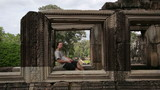 caucasian tourist travel in Ta Prohm temple, angkor, cambodia