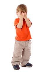 Little boy hide face under hands