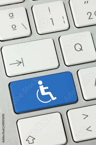 Handicapped keyboard key. Finger
