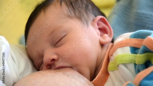 portrait of little baby. breastfeeding of newborn
