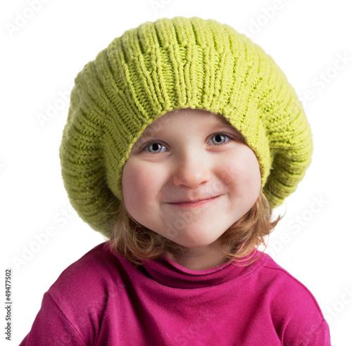 Happy little girl in a knit cap