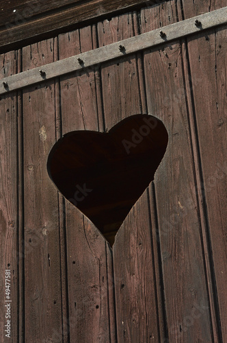 Wooden door with cut out Heart shape