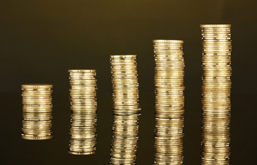 Many coins in columns on dark background