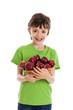 Boy holding basket of red apples