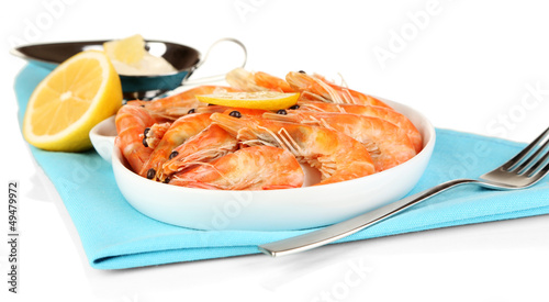 Shrimps with lemon on plate isolated on white