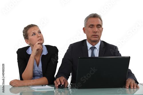 businessman and his assistant working together