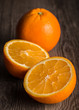Close-up of orange fruit on the old wooden board.