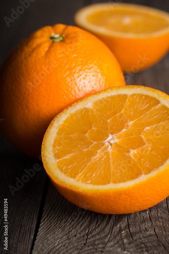 Close-up of orange fruit on wooden board.