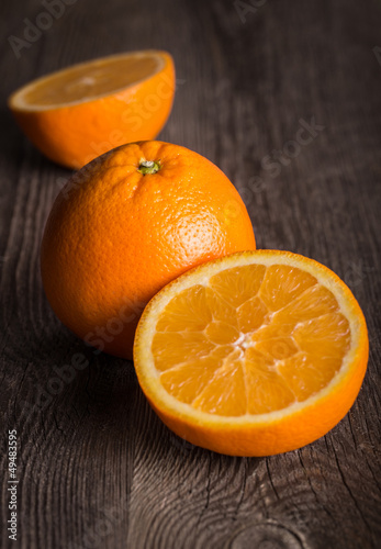 Close-up of orange fruit on on the old wooden table.