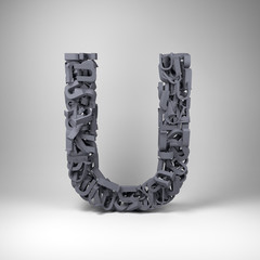 Letter U made out of scrambled small letters in studio setting