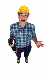 A screaming tradesman holding a power tool