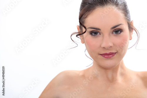 charming brunette posing with bare shoulders