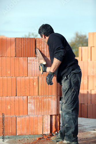Builder laying blocks