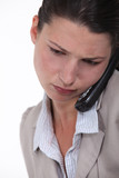 Businesswoman concentrating during call