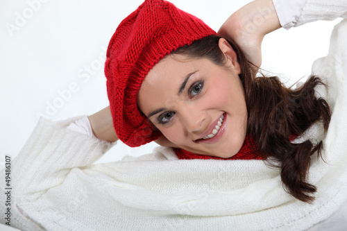 portrait of young woman wearing woolen hat