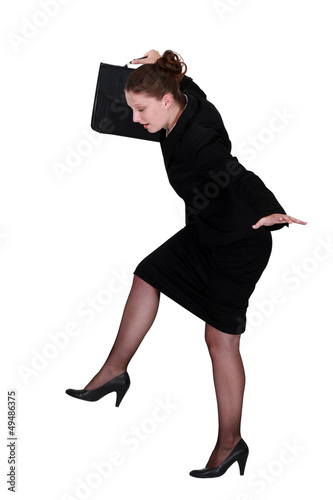businesswoman trying to balance