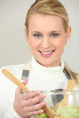 Blond holding salad bowl