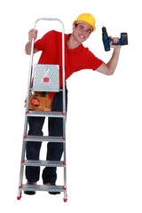 Young carpenter up ladder