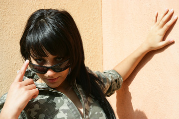 Provocative girl watching over her sunglasses