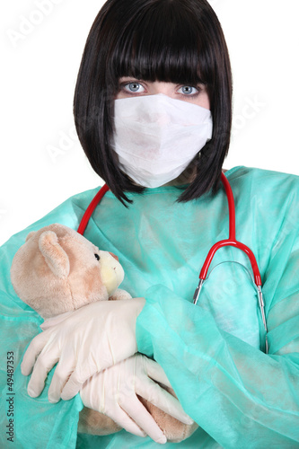 Doctor hugging a teddy bear