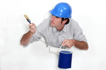 Man with a pot of blue paint