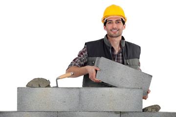 Mason carrying bricks