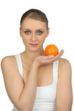 Young woman holding an orange